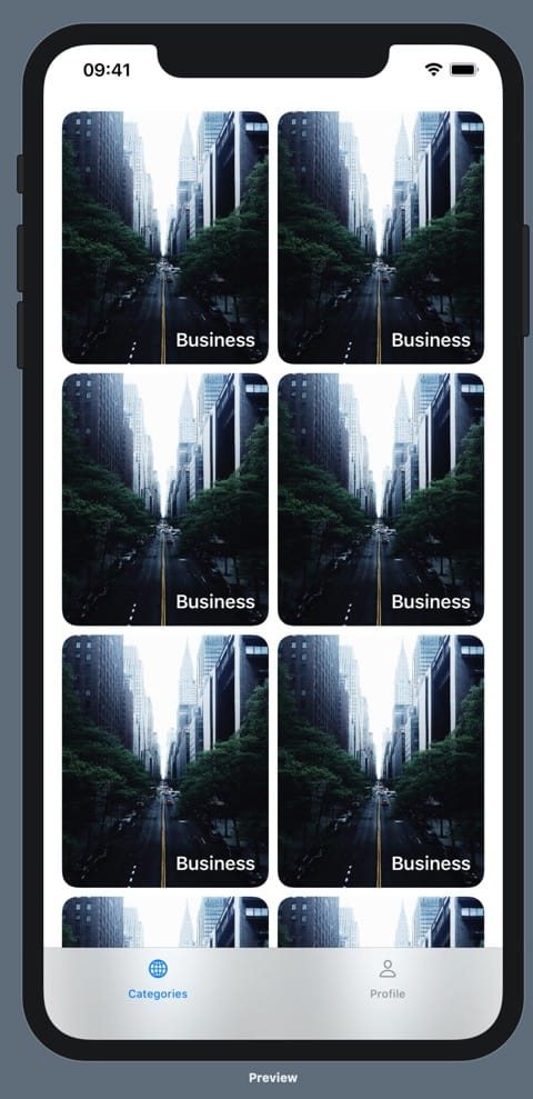 "An iPhone 11 Pro max running our prototype. On the prototype is a bottom tab bar with two options: Categories and Profile. Above the categories tab label is a globe icon, and above the profile tab label is a person icon. The categories tab is blue and the profile tab is black. Above the bottom tab bar, there are six identical images of a foggy New York City taken from above a road, looking down it. There are deep green trees on either side of the road. The images are rectangular, with more height than width, and they are arranged in two columns and three rows. The image has rounded corners and, overlayed in the bottom right corner is the text ""Business"" in white."