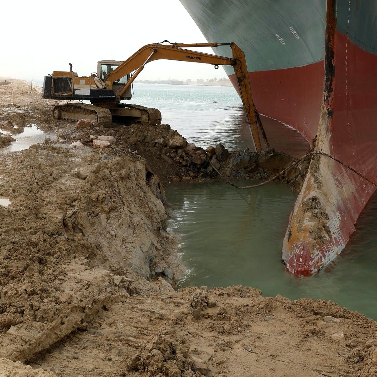A tractor tries to free the Ever Given ship from the Suez Canal.