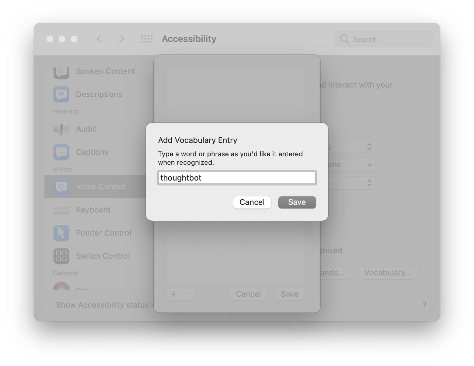 A modal hovering over the Voice Control preference pane titled, 'Add Vocabulary Entry,' with instructions that read, 'Type a word or phrase as you'd like it entered when recognized.' There is a text field with the word 'thoughtbot' entered into it. Screenshot.