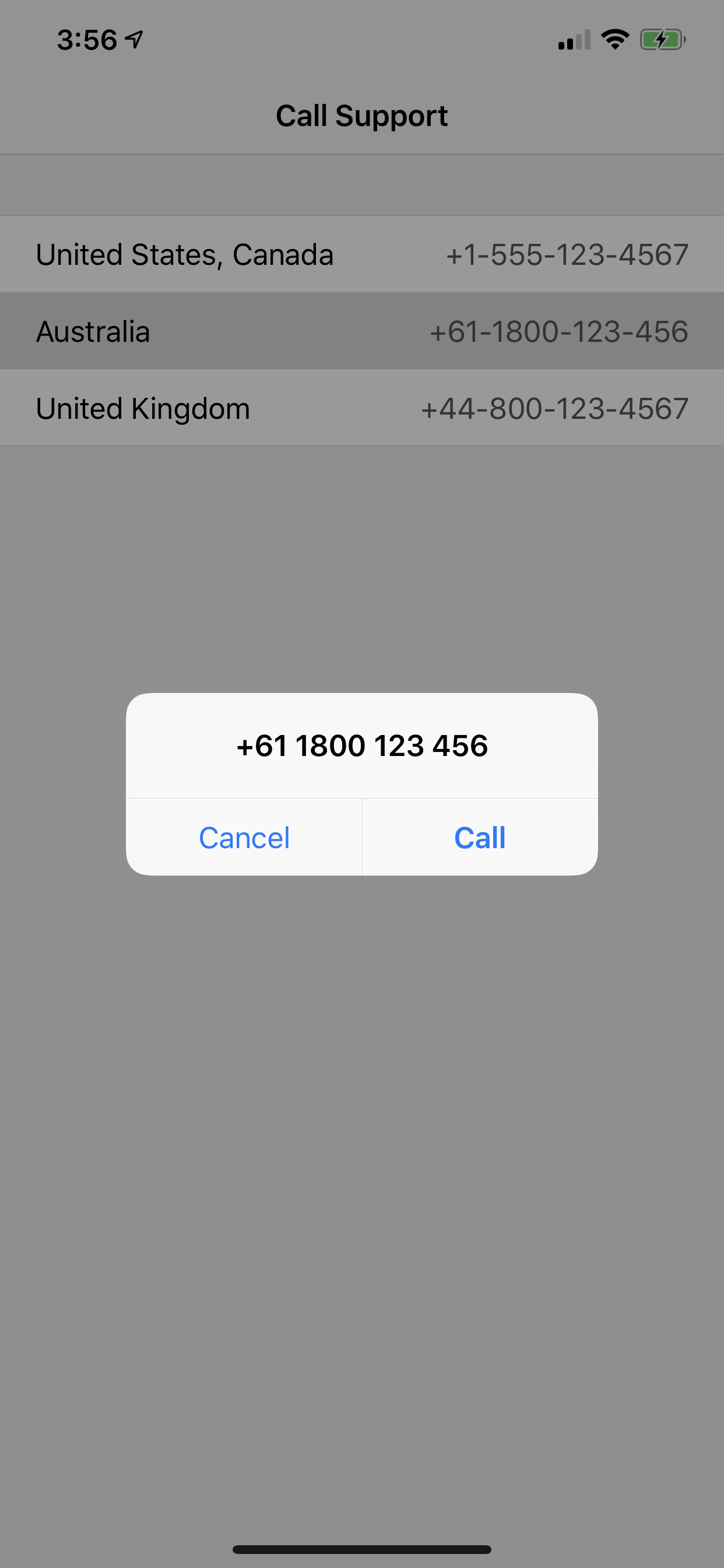 An alert showing the tapped phone number with a prompt to either Call or   Cancel